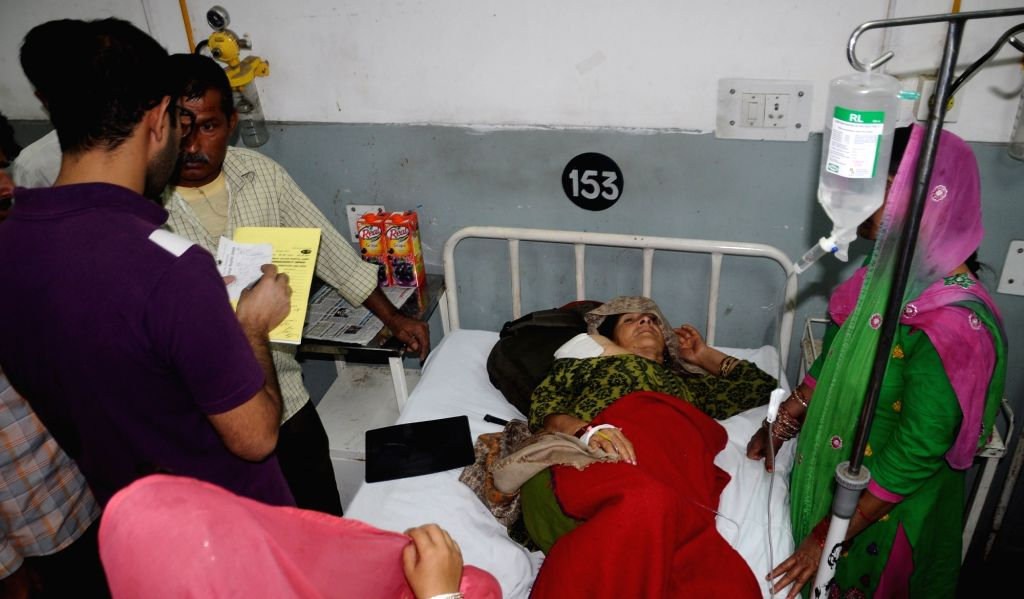 A lady injured in cross border firing at Suchetgarh being treated at a Jammu hospital on Oct 27, 2016.