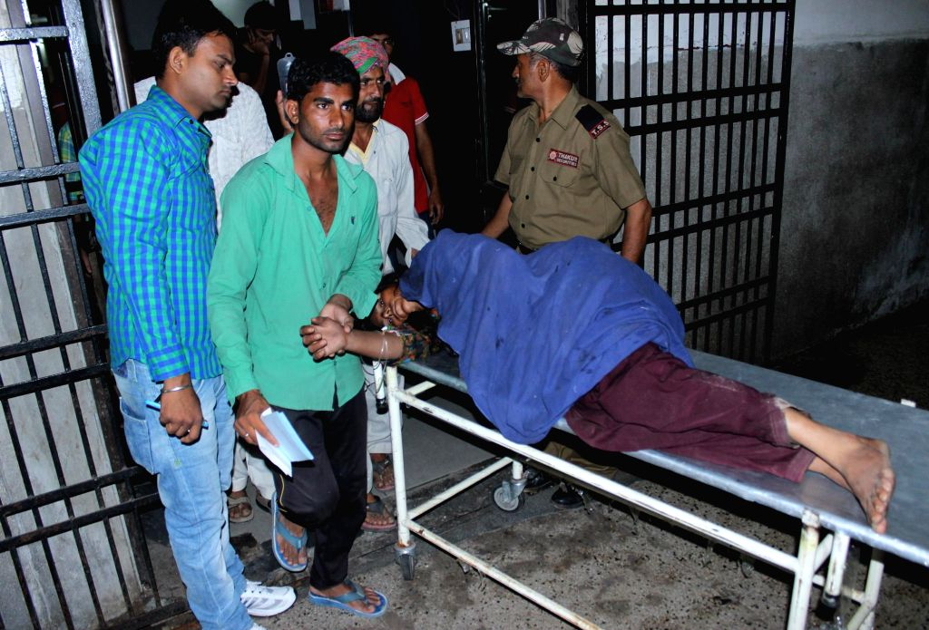 A lady injured in heavy firing by the Pakistani rangers near the international border in RS Pura sector in Jammu district at a hospital in Jammu on Aug. 23, 2014.