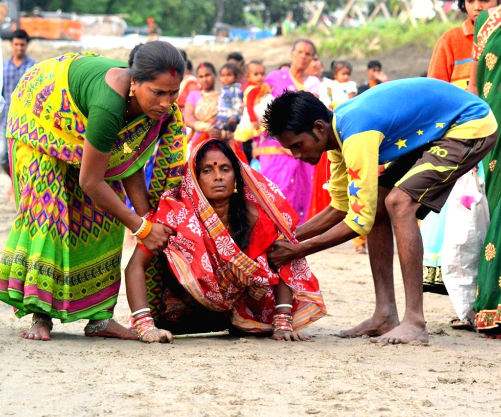A lady performs Chhath ritual in Tezpur of Assam on Nov 17, 2015.
