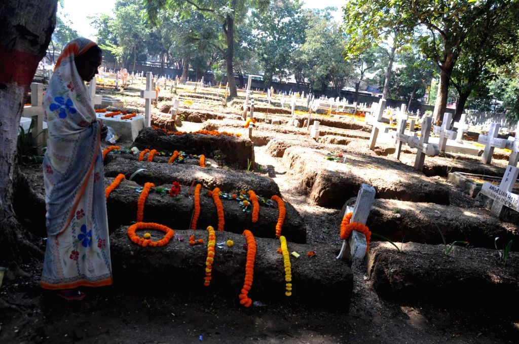 A lady prays at the grave of her deceased relative on All Souls Day in Ranchi, on Nov 2, 2015.