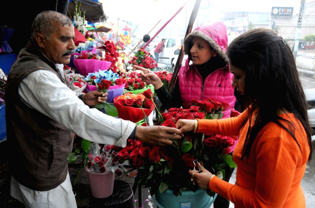 A lady selects roses on Valentine's Day in Amritsar, on Feb 14, 2019.