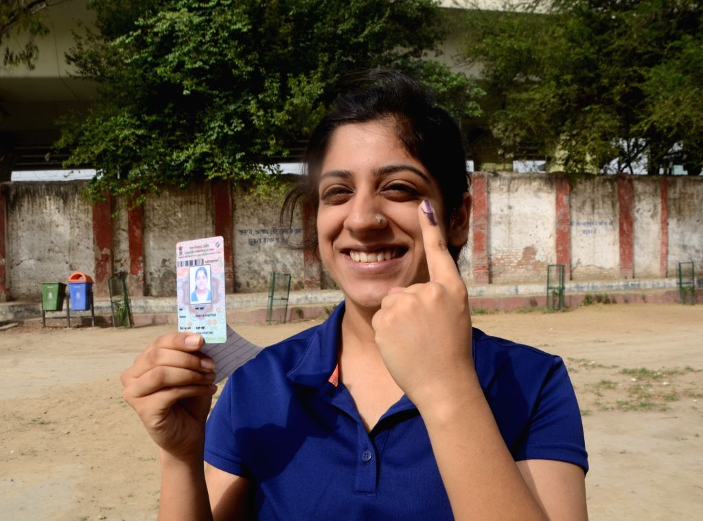 A lady shows her forefinger marked with indelible ink after casting vote during the sixth phase of 2019 Lok Sabha elections, in New Delhi on May 12, 2019.