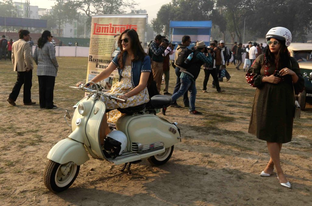 A lady sits on a vintage scooter during vintage motor vehicle rally in Kolkata, on Feb 3, 2019.