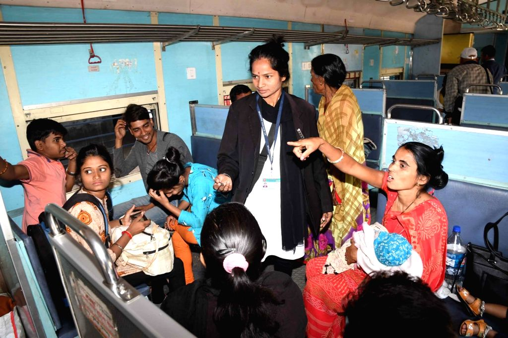 A lady TTE (travelling ticket examiner) checking tickets in a train in Patna on March 8, 2019.