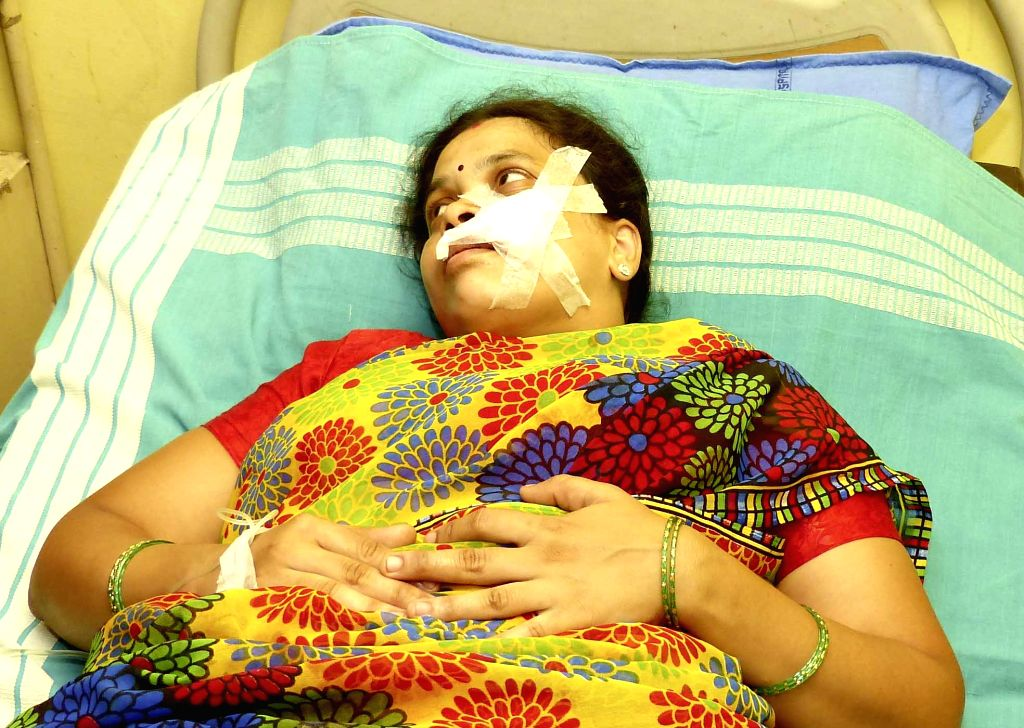 A lady who got injured during a demonstration against amendment in Employees Provident Funds and Miscellaneous Provisions Act, 1952 being treated at Bengaluru hospital, on April 18, 2016.