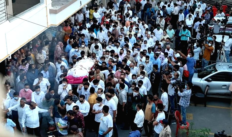 A large number of people joined the funeral procession of businessman MANSUKH HIREN, from his home in Thane this evening.
