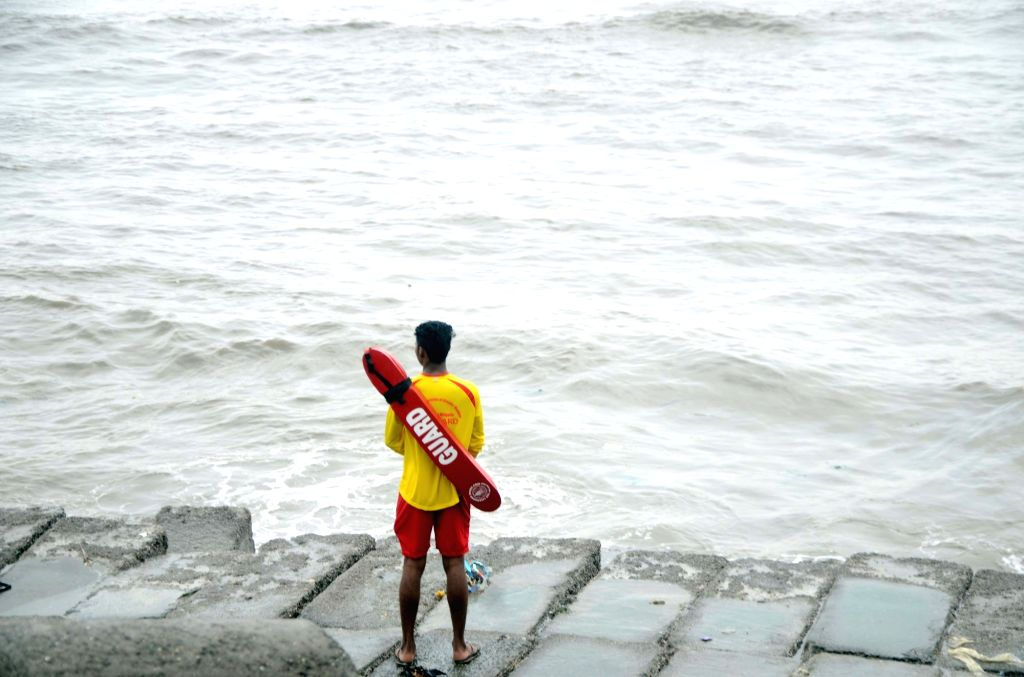 A life guard on duty at a sea beach in Mumbai on June 13, 2019. Life guards on beaches across the city have been asked to ensure that nobody ventures into the sea, in the wake of Cyclone Vayu.