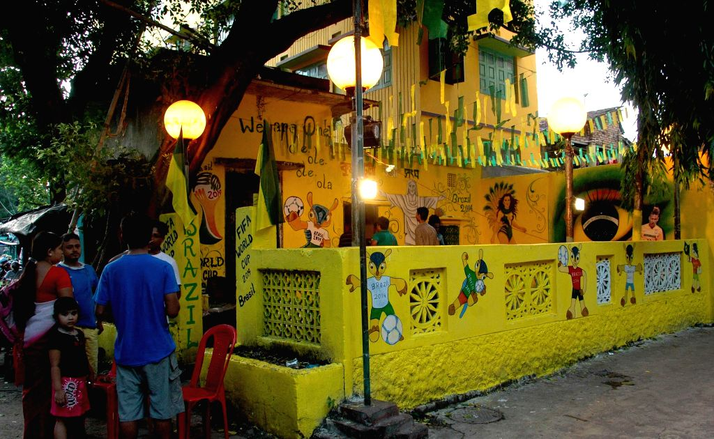 A local club painted in the colours of Brazilian football team in Kolkata on June 27, 2014.