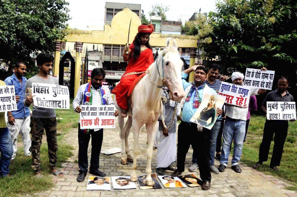 A Lok Janshakti Party (LJP) activist dressed up as Rani Laxmibai takes part in a demonstration against the Maharashtra Government, expressing solidarity with actress Kangana Ranaut, in Mumbai ... - Kangana Ranaut