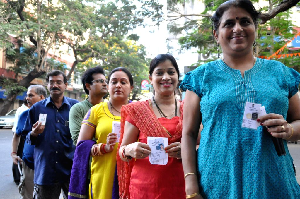 A long queue of locals to cast their vote  for the Lok Sabha election in Panaji on April 12, 2014.