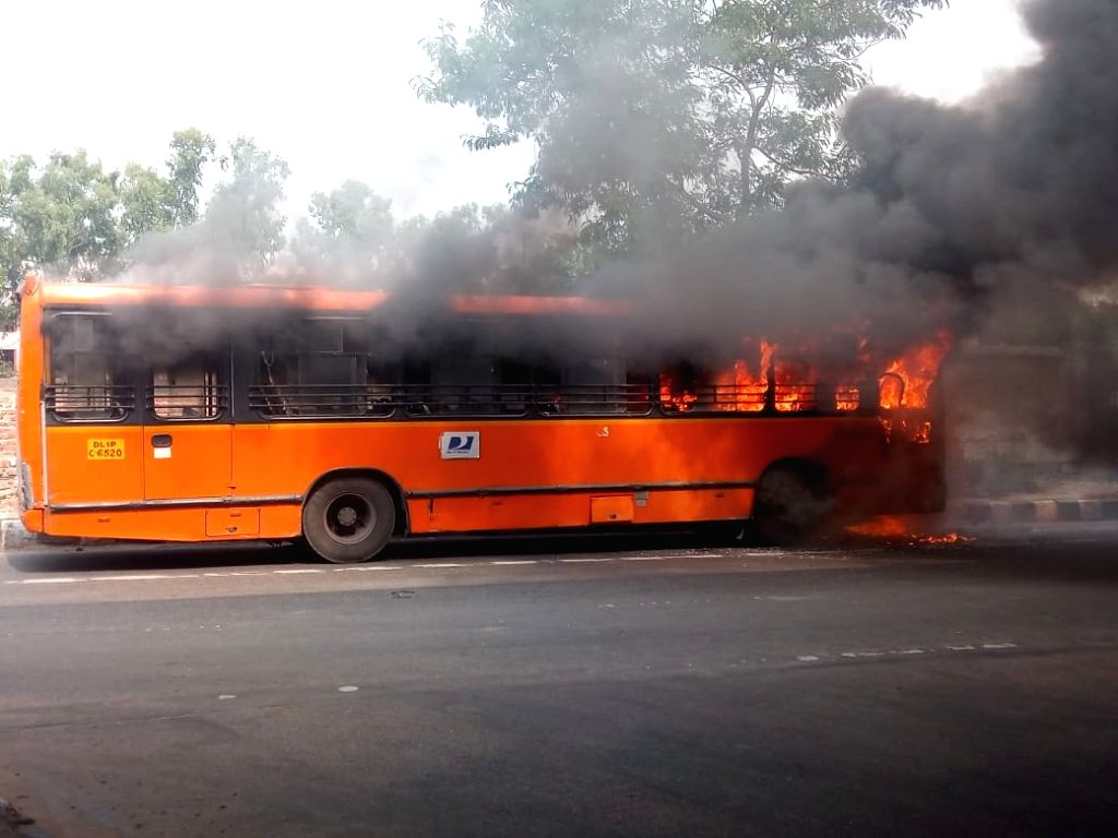 A low-floor DTC bus catches fire in Delhi's Karkardooma area, on Sep 16, 2019.