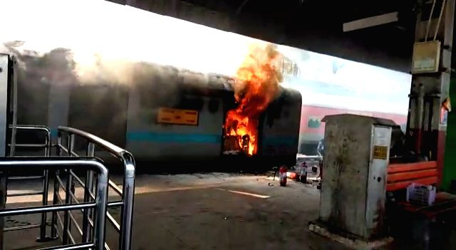 A major fire breaks out in the power car of the Chandigarh-Kochuvalli Express at platform No. 8 of the New Delhi railway station on Sep 6, 2019. (Photo: IANS)