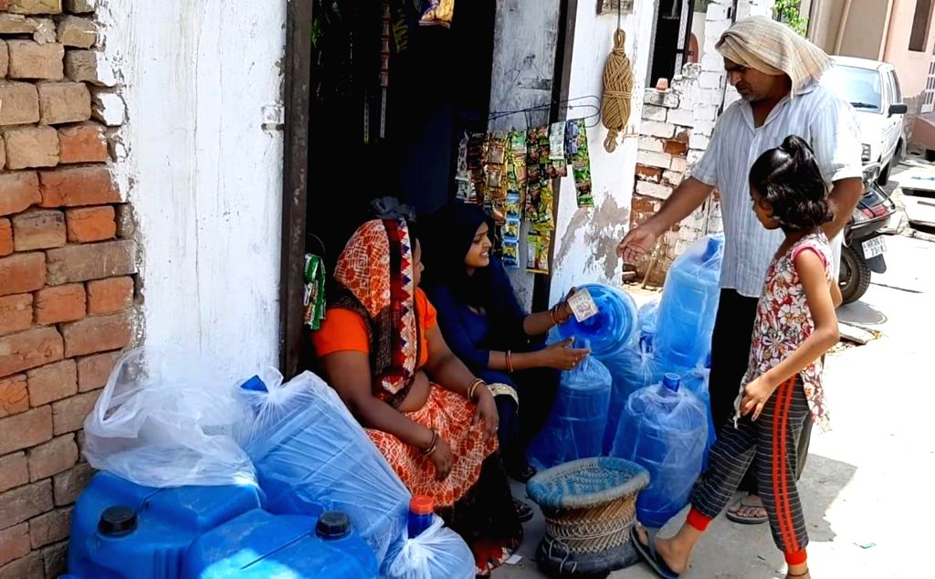 A makeshift shop set up by locals to sell water bottles and buckets filled with 'miracle' water that is believe to be a panacea for several diseases, including diabetes, put up at Gujriwas ...