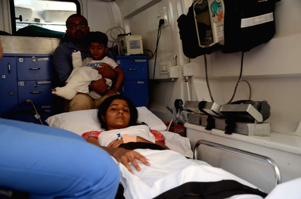 A man arrives at a hospital to get his injured wife and son treated at a hospital after a portion of an overhead pedestrian bridge outside the Chhatrapati Shivaji Maharaj Terminus came ...