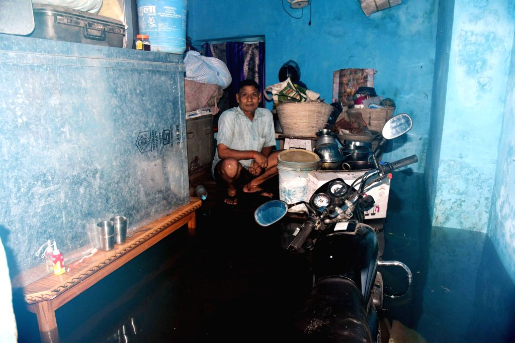 A man at his home inundated with flood water in Patna on Sep 30, 2019.