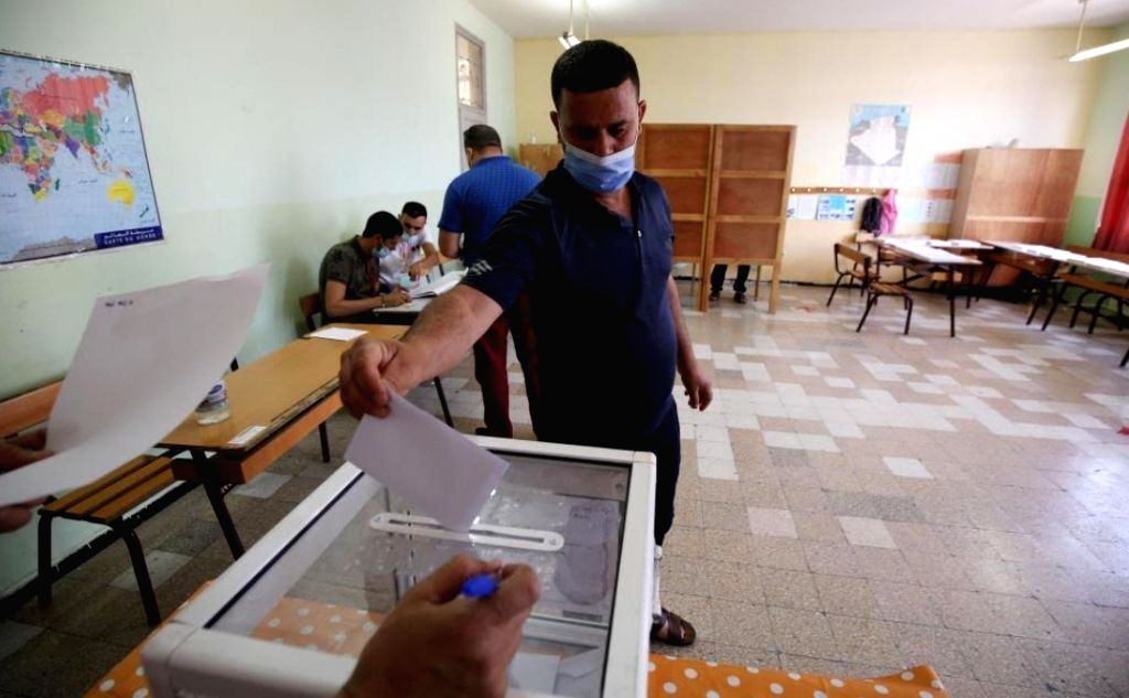 A man casts his ballot for the parliamentary elections at a polling station in Algiers, Algeria, on June 12, 2021.