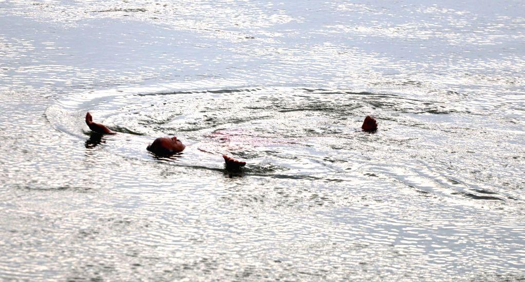 A man cools himself in the Ganaga river in Prayagraj on June 7, 2019.