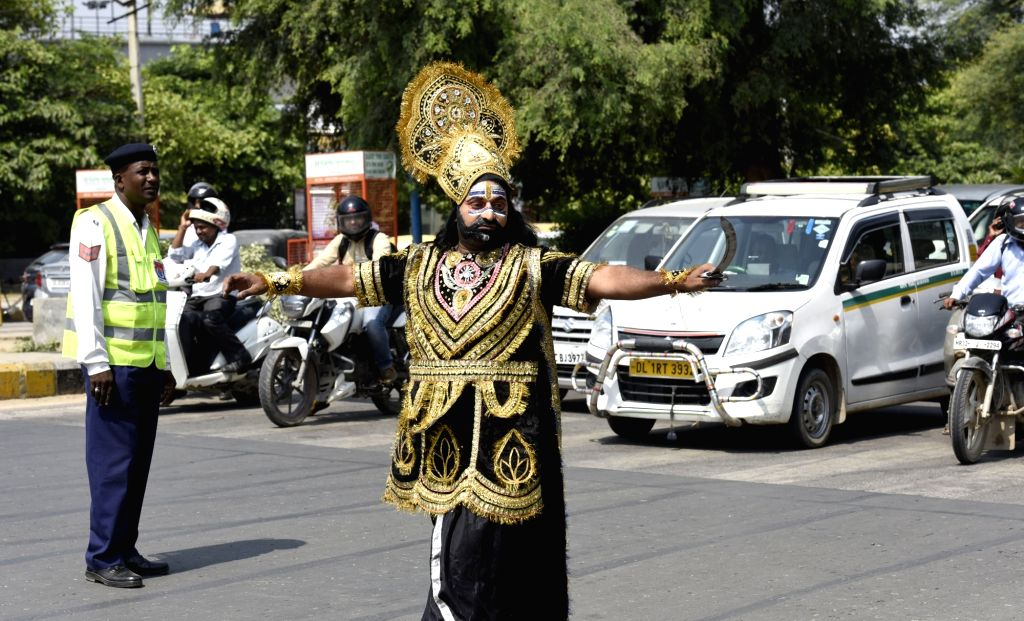 A man disguised as Raavan - mythological character from Ramayana, an ancient Indian epic poem spreads traffic awareness in Gurugram during Navratra in Gurugram on Sept 29, 2017.