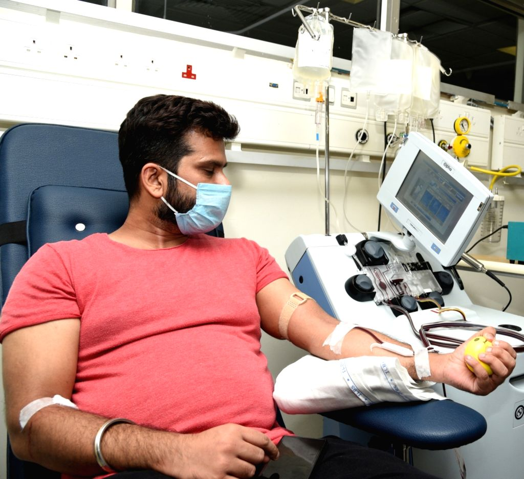 A man donates plasma at India's first plasma bank set up at the Institute of Liver and Biliary Sciences (ILBS) Hospital, in New Delhi on July 10, 2020.