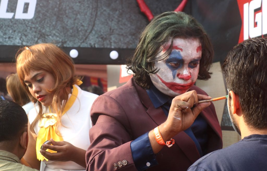 """A man dressed up as fictional character """"Joker"""" at the three-day fest - """"Comic Con"""" in New Delhi on Dec 7, 2018."""