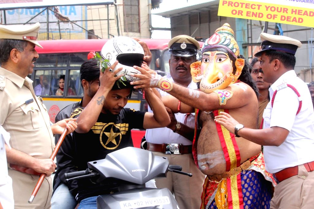 A man dressed up as Lord Ganesha participates in 'Road Safety Awareness Programme' organised by Bangalore Traffic Police, in Bengaluru on July 25, 2018.