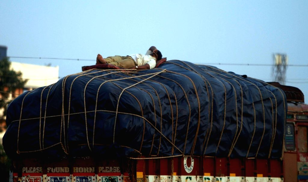 A man enjoys his siesta​ atop a truck in Chennai on May 11, 2017.
