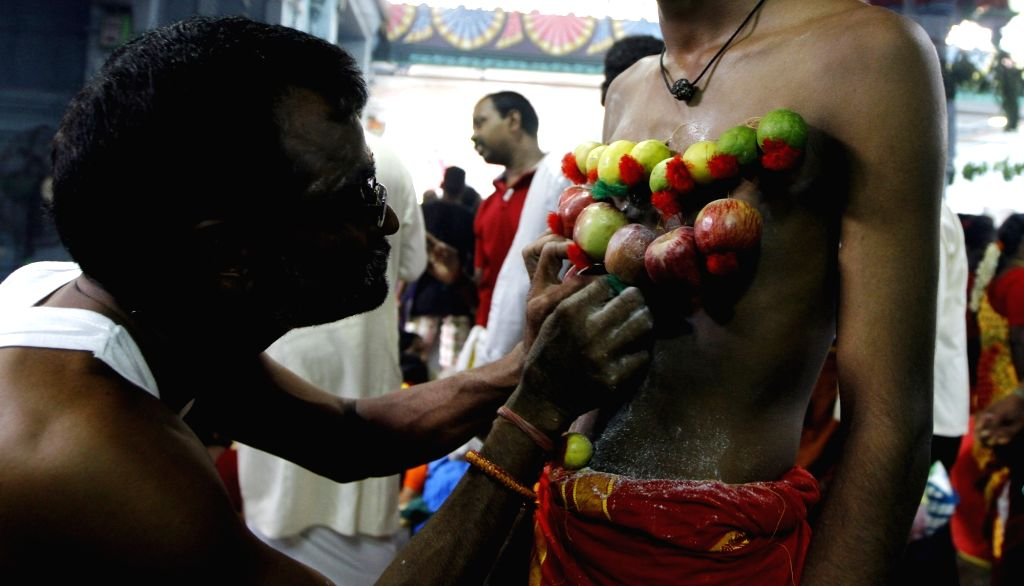 A man gets his body threaded with lemons on the third day of Aadi Perukku in Chennai, on Aug 5, 2016.