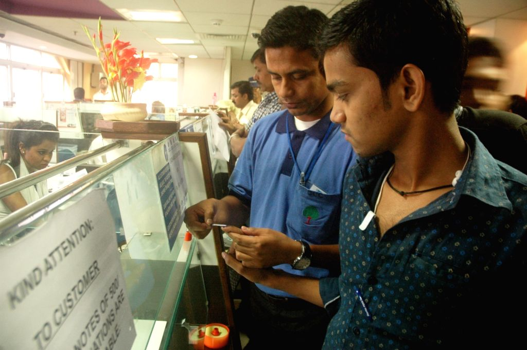 A man gets his finger marked with indelible ink at a bank to exchange demonetised Rs 1000 and 500 notes in Kolkata on Nov 16, 2016.