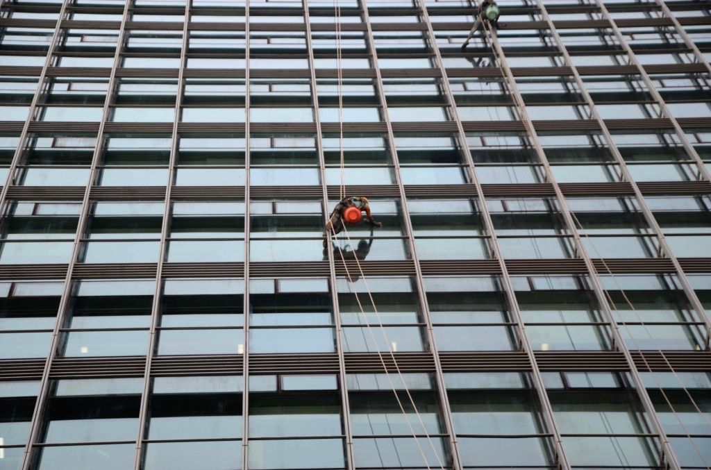 A man hanging on the high-rise building seen cleaning windows in Mumbai, on March 6, 2019.