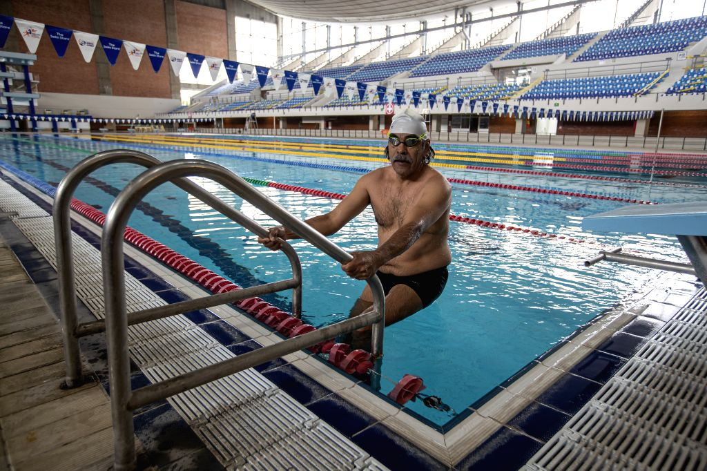 A man is seen in a natatorium in Mexico City, Mexico, Aug. 10, 2020. Some natatoriums in Mexico City have reopened to the public with epidemic prevention ...