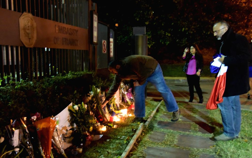 :A man lays a flower at the French Embassy in Washington D.C., Nov. 13, 2015. Over 100 people were killed in a mass hostage-taking at a Paris concert hall ... - Arvind Kejriwal