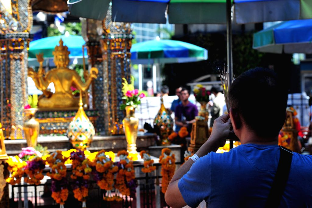 A man prays at the Erawan Shrine at Rajprasong intersection in Bangkok, Thailand, Aug. 19, 2015. As the traffic at an intersection near the blasted Erawan Shrine in ...