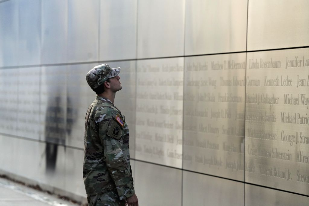 A man reads names of the 9/11 attacks' victims inscribed on the Empty Sky memorial at Liberty State Park in Jersey City of New Jersey, the United States, on ...