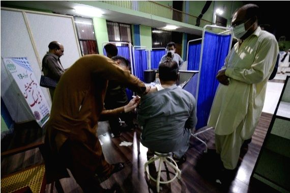 A man receives a dose of the COVID-19 vaccine at a vaccination center in Rawalpindi, Punjab Province, Pakistan, on May 19, 2021.