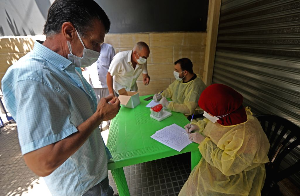 A man registers for a polymerase chain reaction (PCR) test for COVID-19 in Beirut, Lebanon, July 14, 2020. Lebanon's number of COVID-19 infections increased on ...