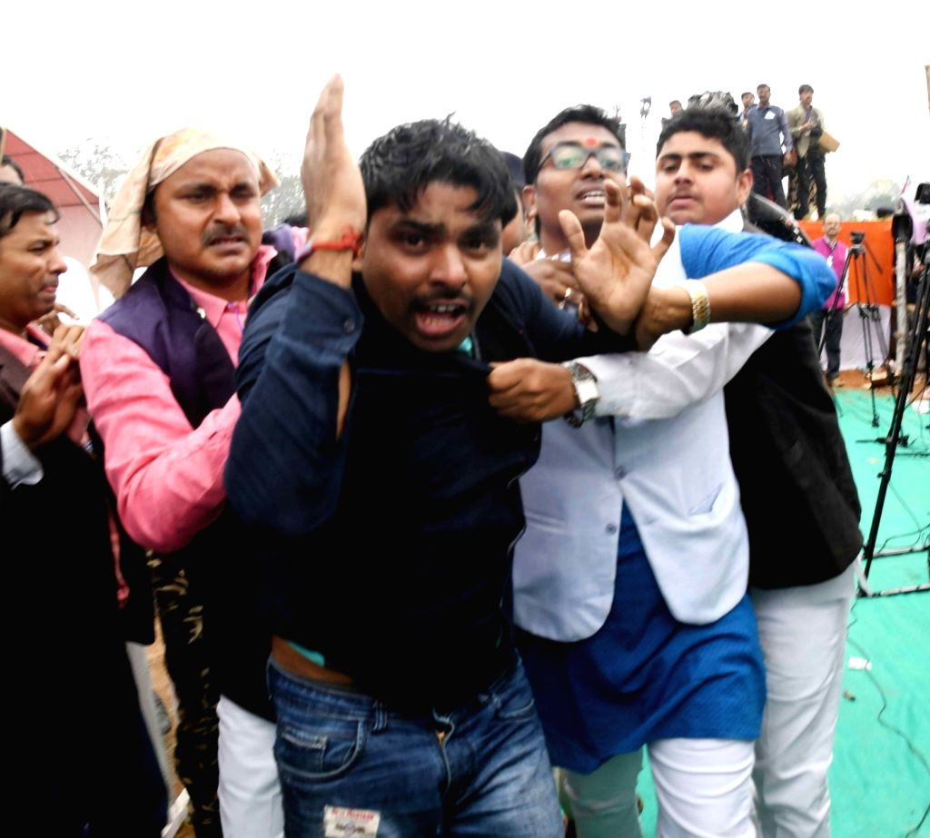 A man seen getting thrashed for showing black flag during 'Sankalp Rally' of Prime Minister Narendra Modi, in Patna, on March 3, 2019. - Narendra Modi