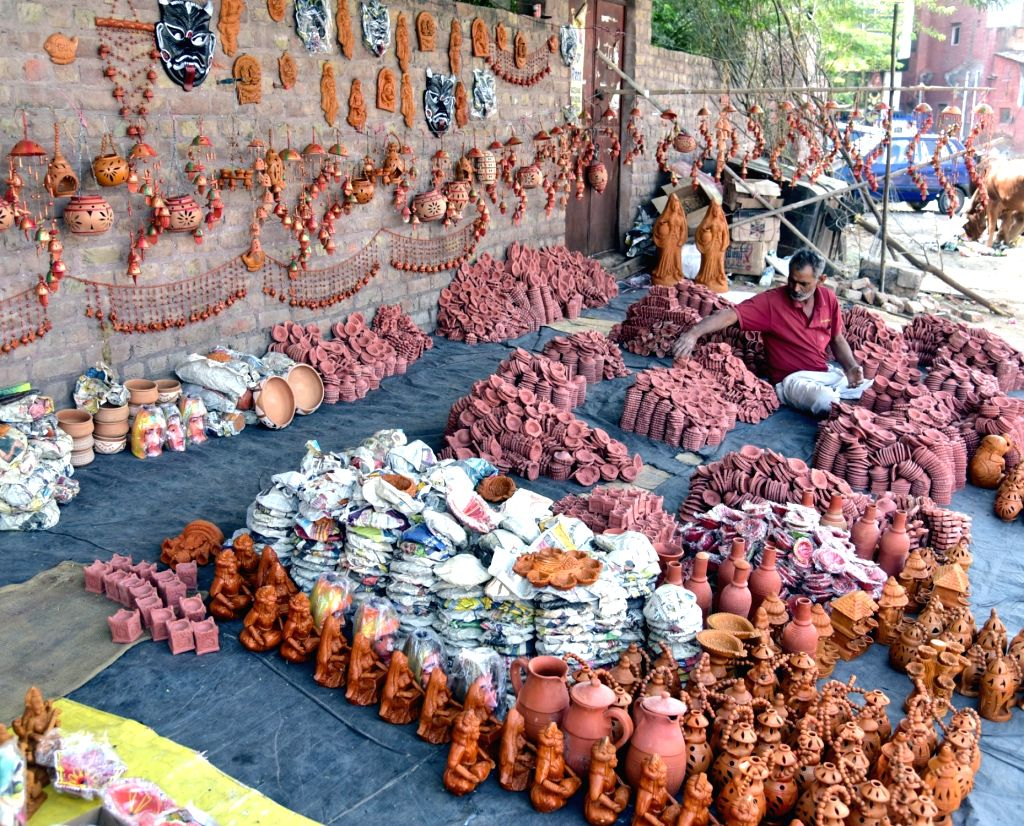 A man sells different varieties of earthen lamps - 'diyas' at a street side market, ahead of Diwali on Oct 25, 2018.