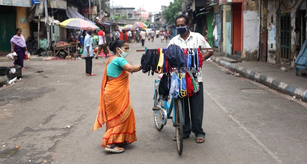 A man sets out to sell homemade masks in Kolkata  during the extended nationwide lockdown imposed to mitigate the spread of coronavirus; on Apr 22, 2020.
