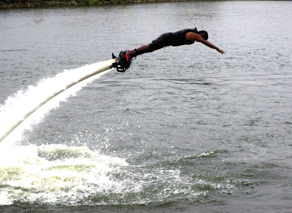 A man showcases a stunt at Sankey Lake during Namma Bengaluru Habba (Bengaluru Festival) jointly organised by the Karnataka government in Bengaluru on Aug 20, 2017.