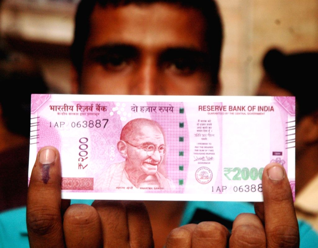 A man shows his finger marked with indelible ink at a bank after exchanging demonetised Rs 1000 and 500 notes in Kolkata on Nov 16, 2016.