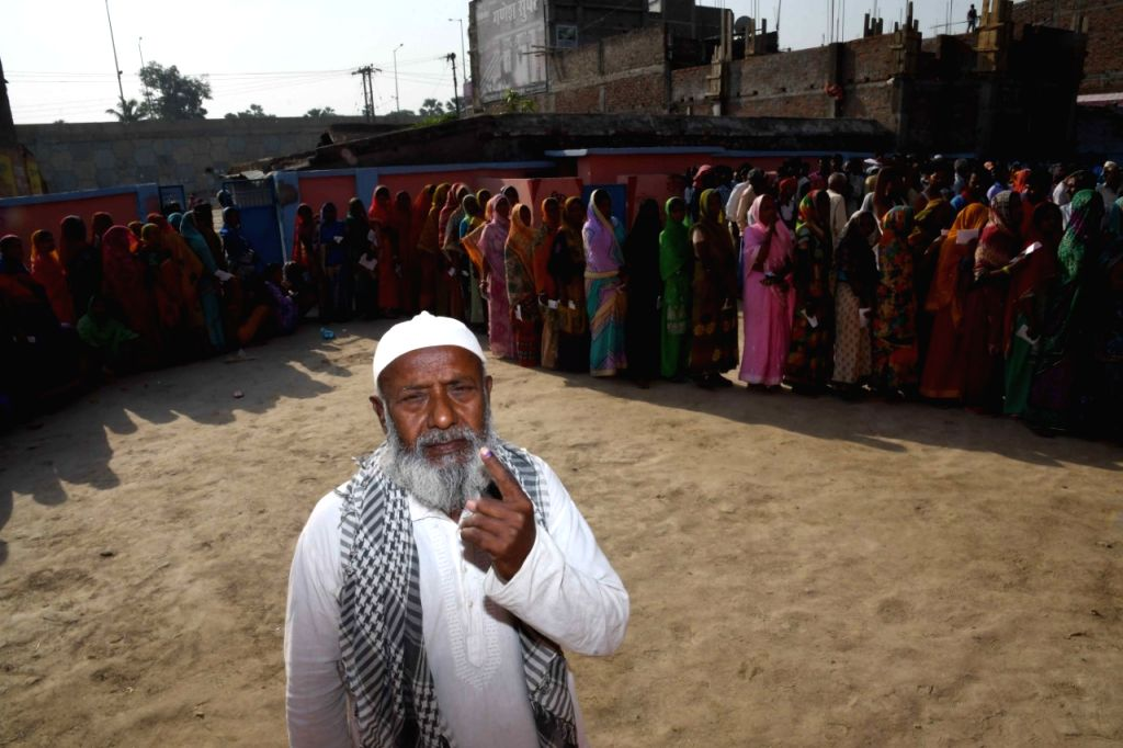 A man shows his forefinger marked with indelible ink after casting vote during the sixth phase of 2019 Lok Sabha elections, in Vaishali, Bihar on May 12, 2019.