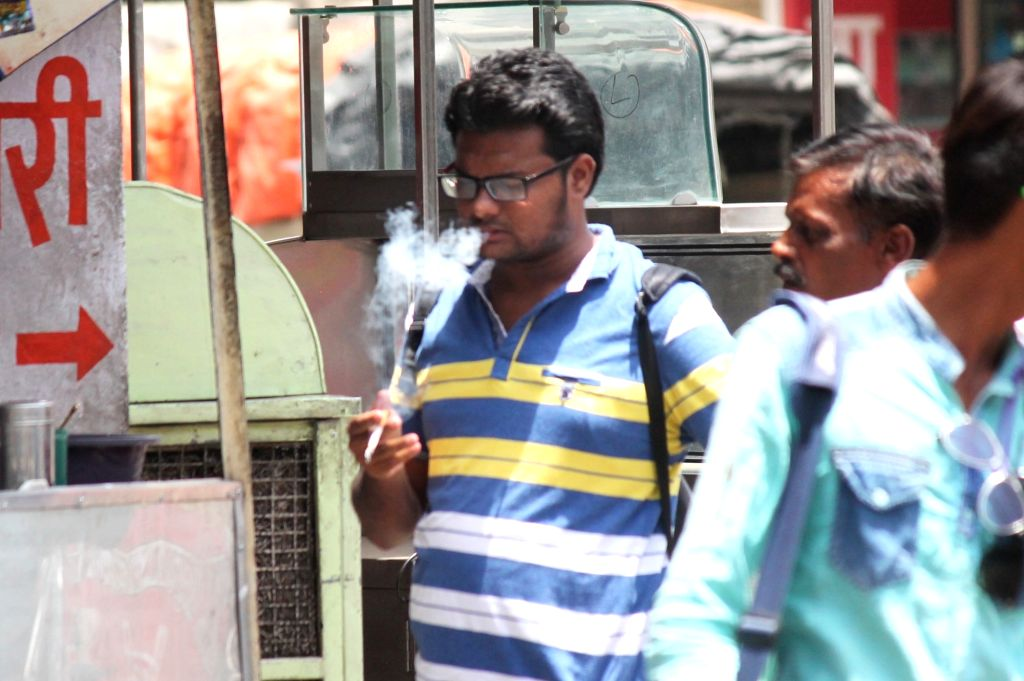 A man smokes in public. June 31 is observed as World No Tobacco Day.