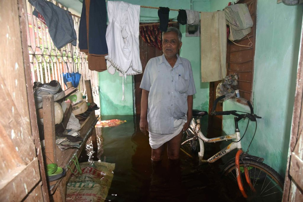 A man stands inside an inundated house in flood-affected Patna, on Sep 30, 2019.