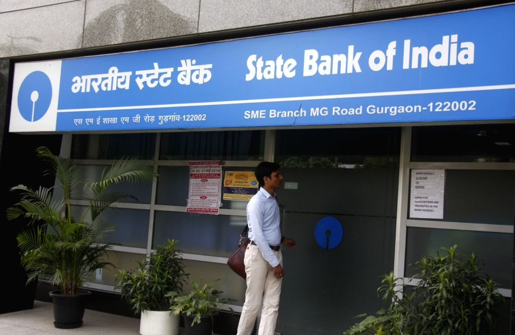 A man stands outside a deserted State Bank of India branch office during the second day of the nationwide bank strike spearheaded by the United Forum of Bank Unions (UFBU), an umbrella body ...
