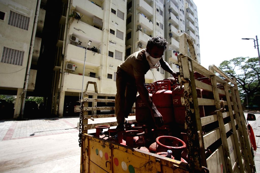 A man supplies LPG Gas cylinders to households on Day 7 of the 21-day nationwide lockdown imposed to contain the coronavirus, in Chennai on March 31, 2020.