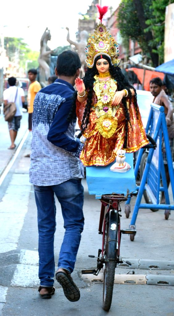 A man takes home an idol of goddess Lakshmi ahead of LakshmiPuja in Kolkata on Oct 4, 2017.