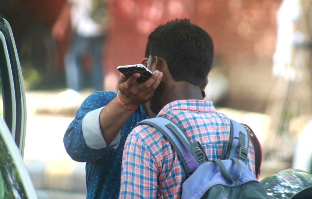 A man talks over cell phone. (File Photo: IANS)
