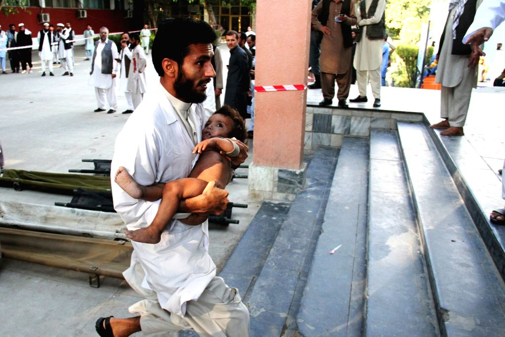 A man transfers an injured child to a hospital after an earthquake in Jalalabad, capital of eastern Nangarhar province, Afghanistan, Oct. 26, 2015. Preliminary ...
