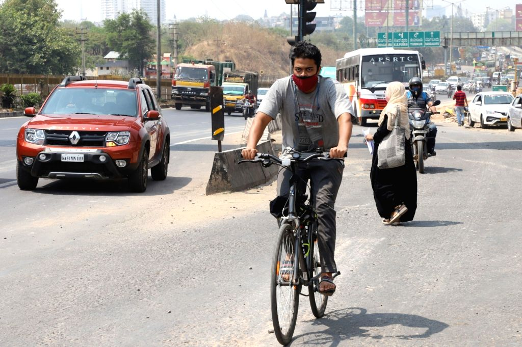 A man using a bicycle to reach his destination at Airport road during a strike by KSRTC and BMTC employees, in Bengaluru on Saturday 10th April 2021.(photo: Dhananjay Yadav/IANS) - Dhananjay Yadav