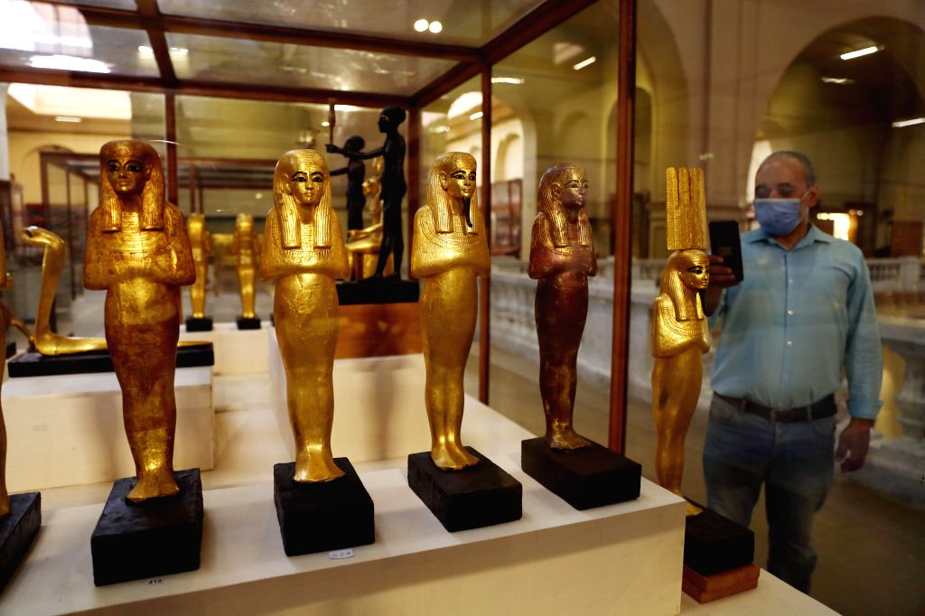 A man visits the Egyptian Museum in Cairo, Egypt, on July 1, 2020. Egypt reopened on Wednesday the Egyptian Museum, the Giza Pyramids, and Temple of Luxor for the ...